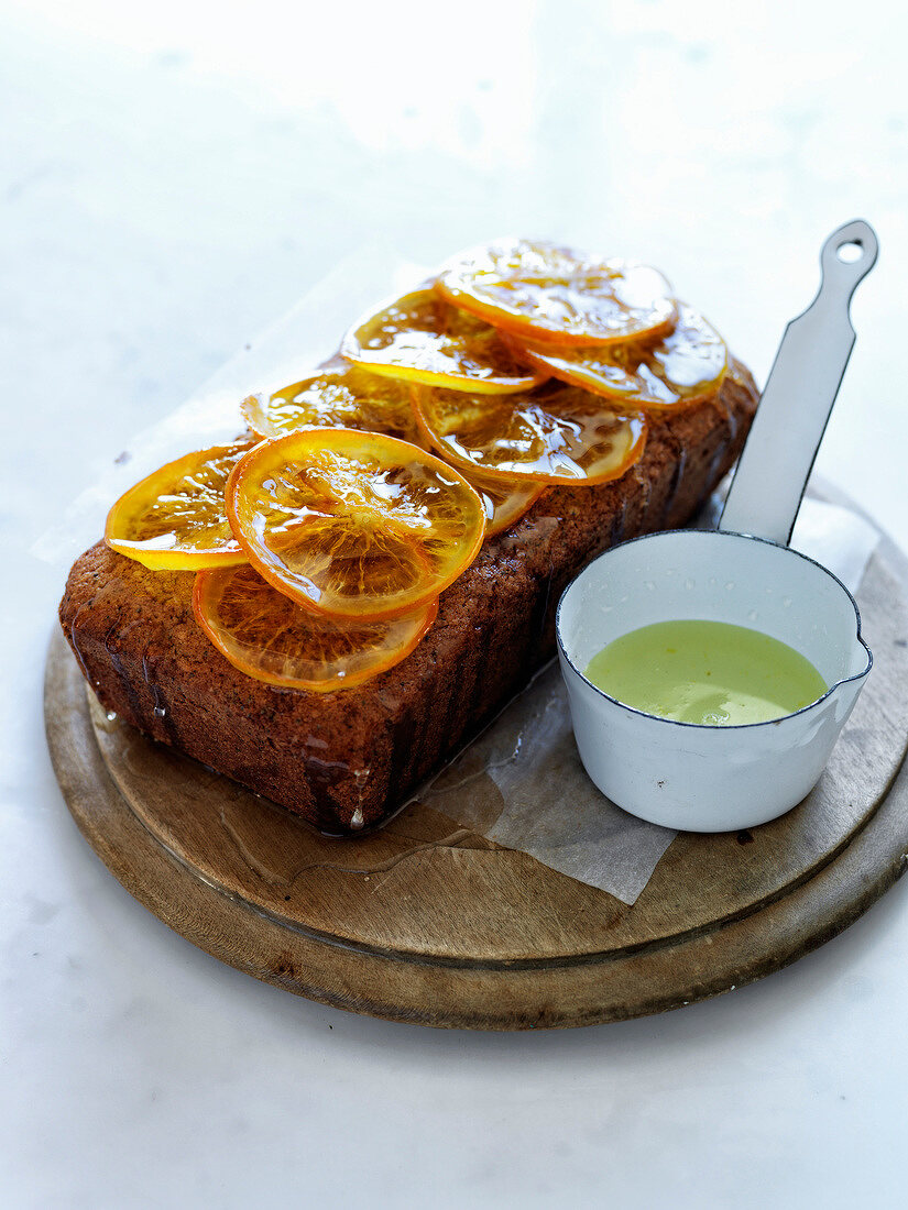 Walnut flour cake with confit orange and syrup topping