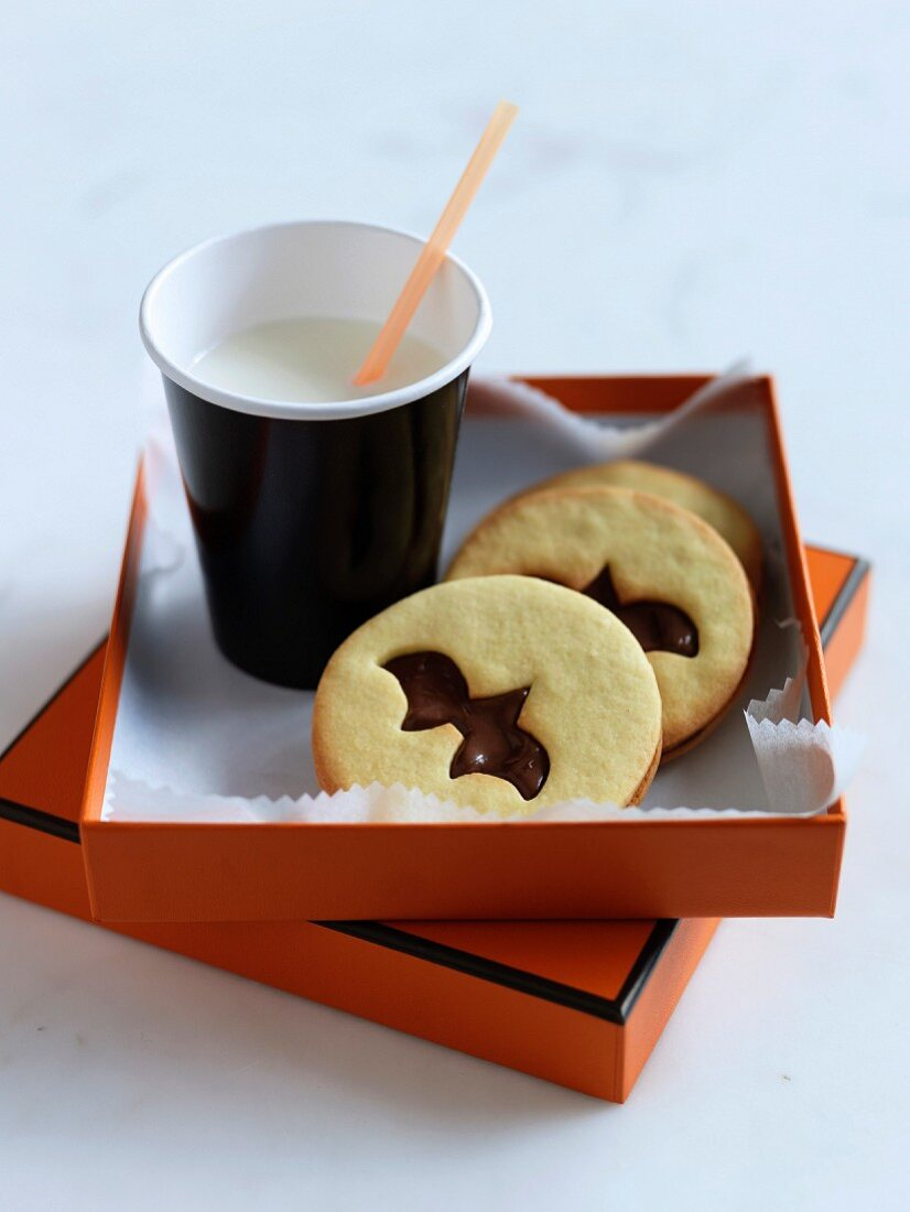 Bat shortbread and chocolate cookies iced milk for Halloween