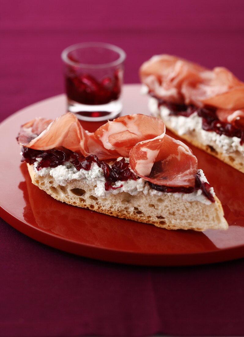 Coppa, horseradish sauce and onion jam open sandwiches
