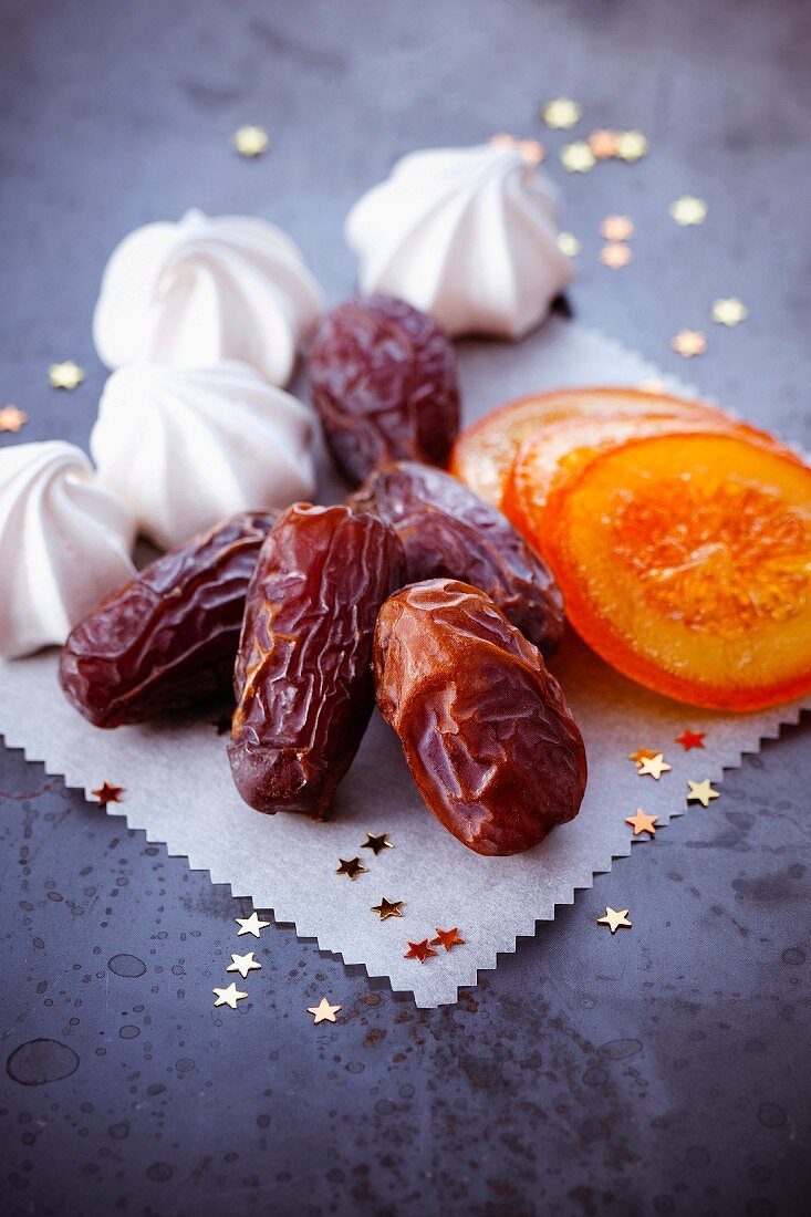 Dates, meringues and sliced confit oranges