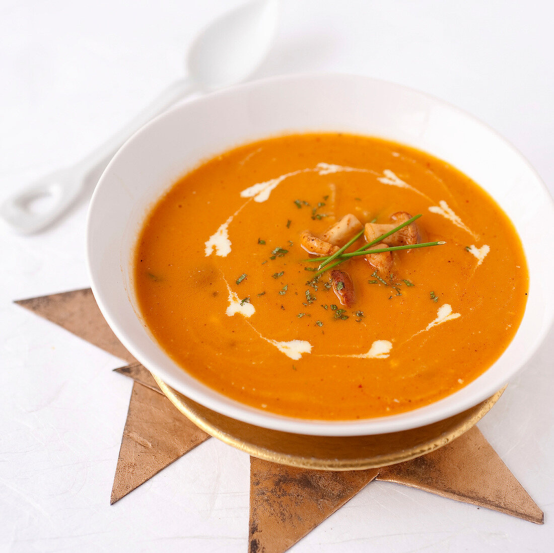 Cream of pumpkin soup with chanterelles and confit chestnuts