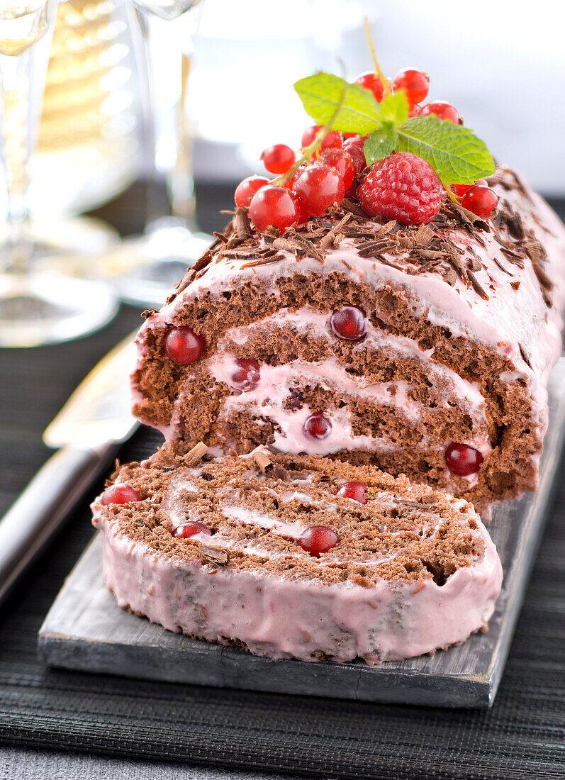 Chocolate and raspberry-redcurrant cream rolled log cake