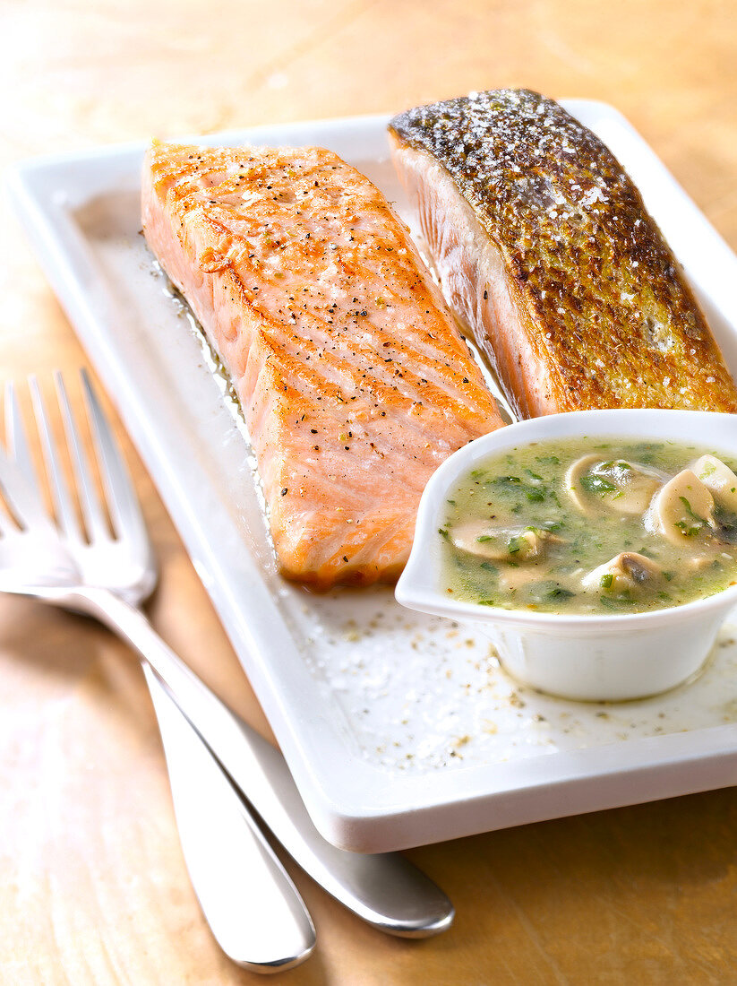 Salmon cooked on one side with mushroom sauce