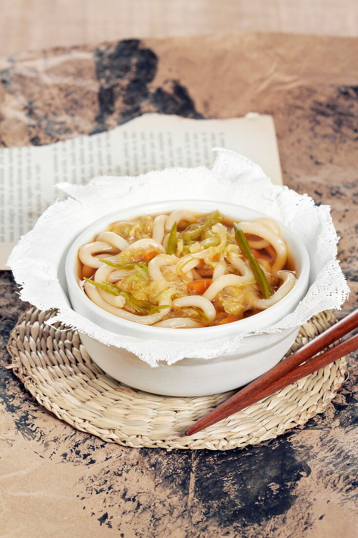 Miso-style rice noodle, cabbage, green bean and carrot soup