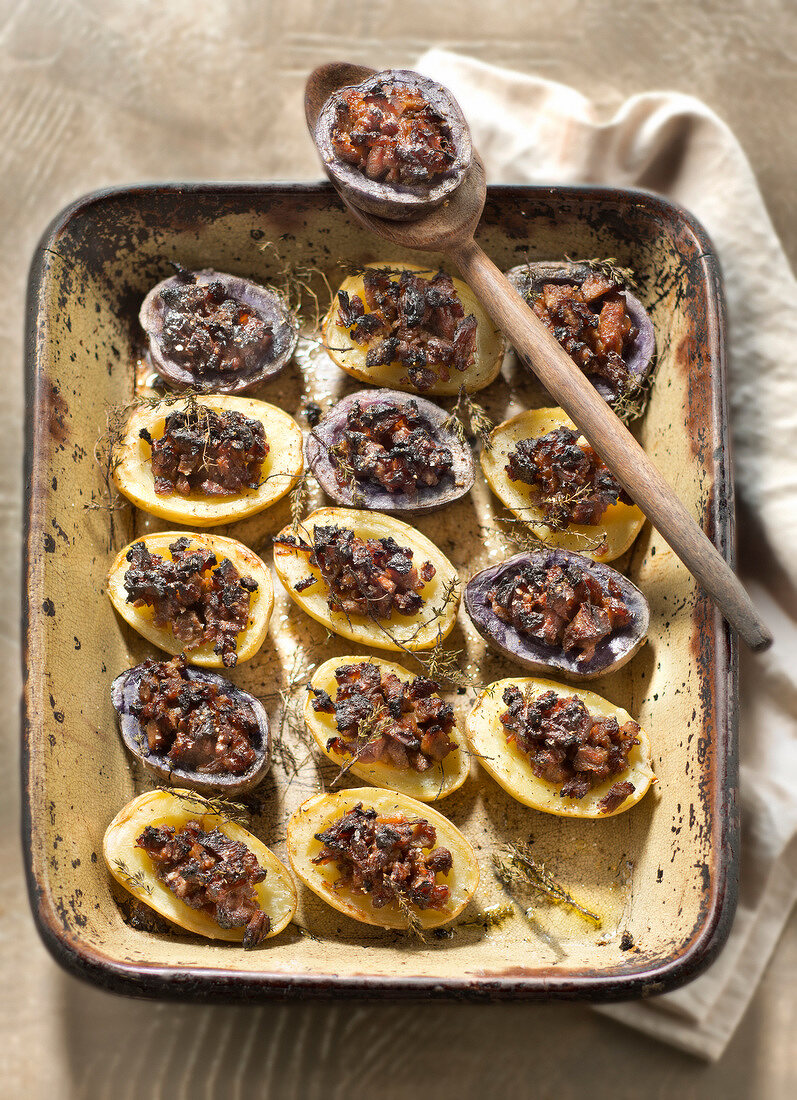 Baked potatoes stuffed with lamb,honey and spices
