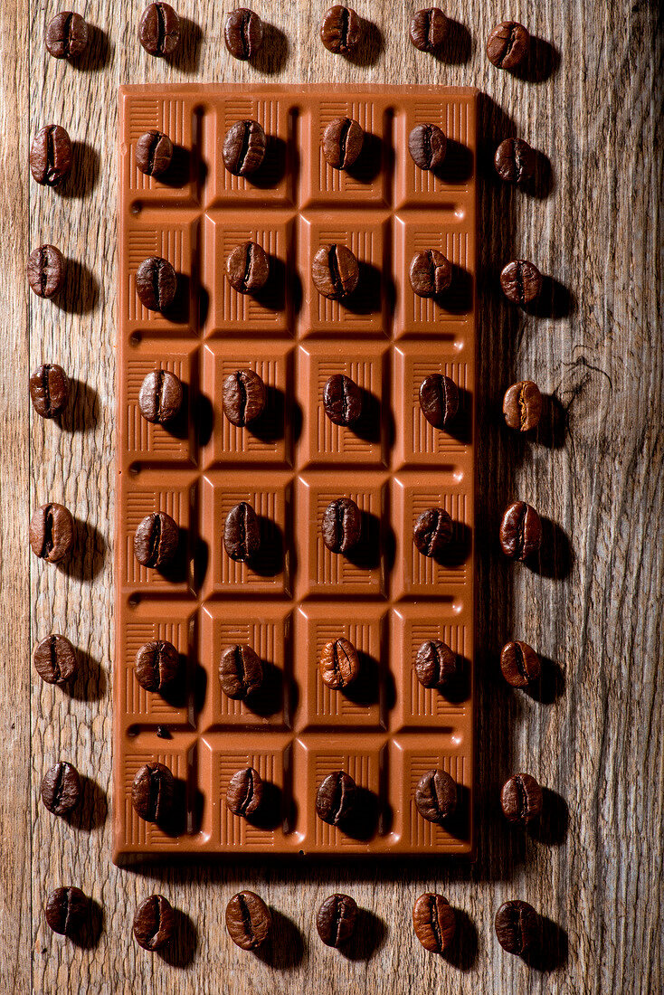 Coffee beans on squares of chocolate