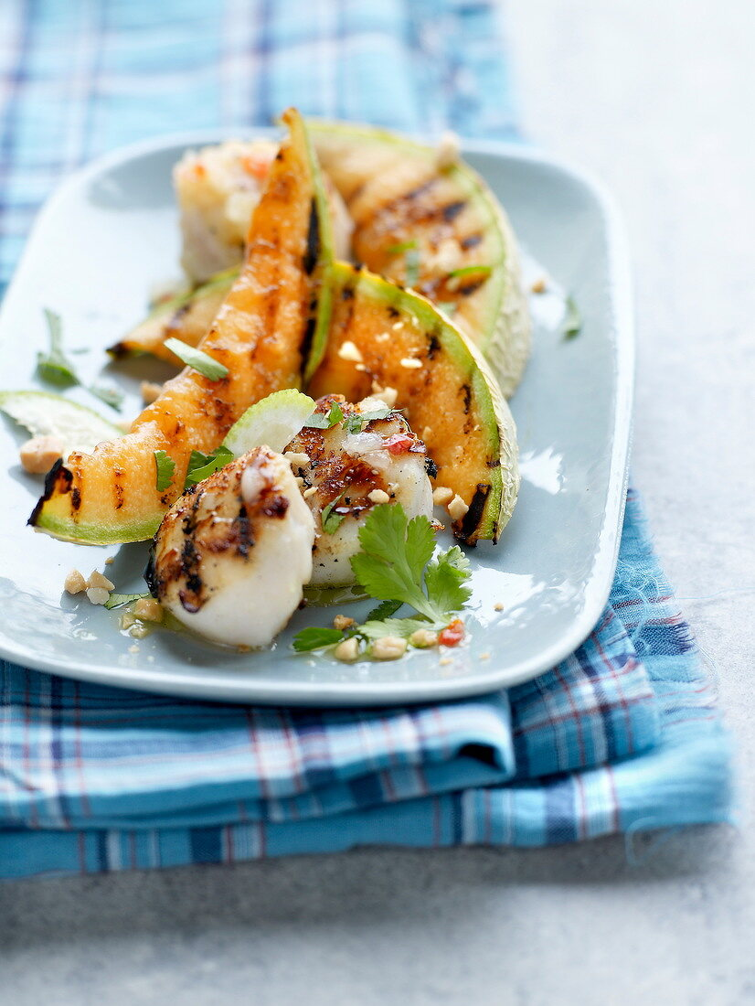 Roasted scallops and sliced melon