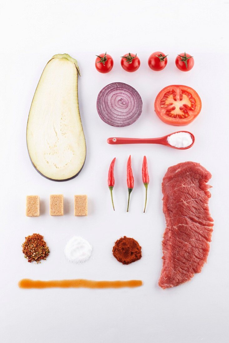 Composition with a raw piece of meat