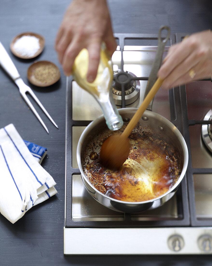 Deglazing the gravy with white wine