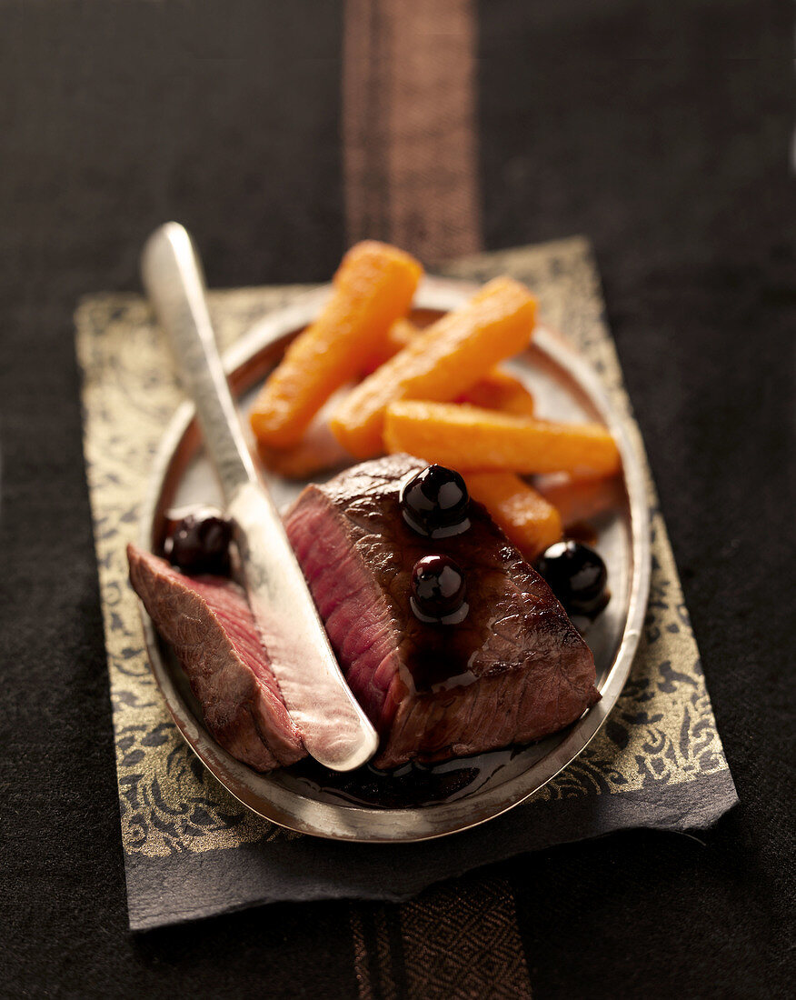 Bison with blueberries and sweet potato french fries