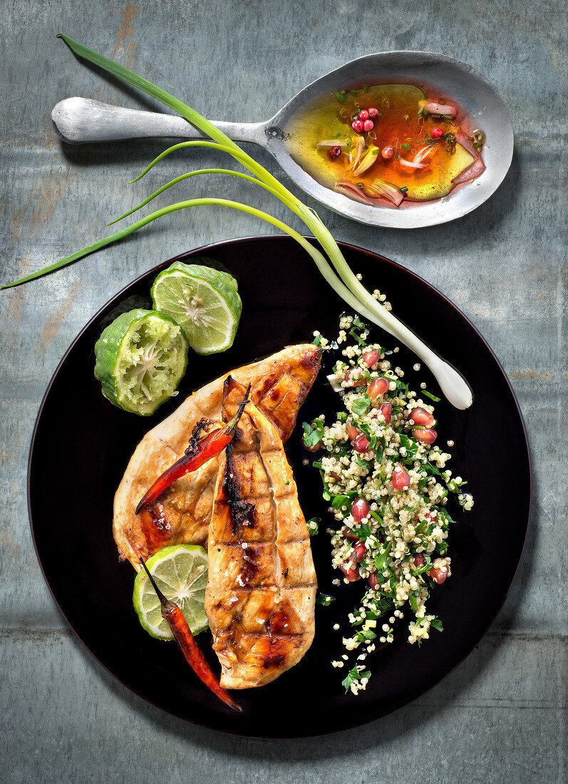 marinated chicken with combava,quinoa and pomegranate tabbouleh