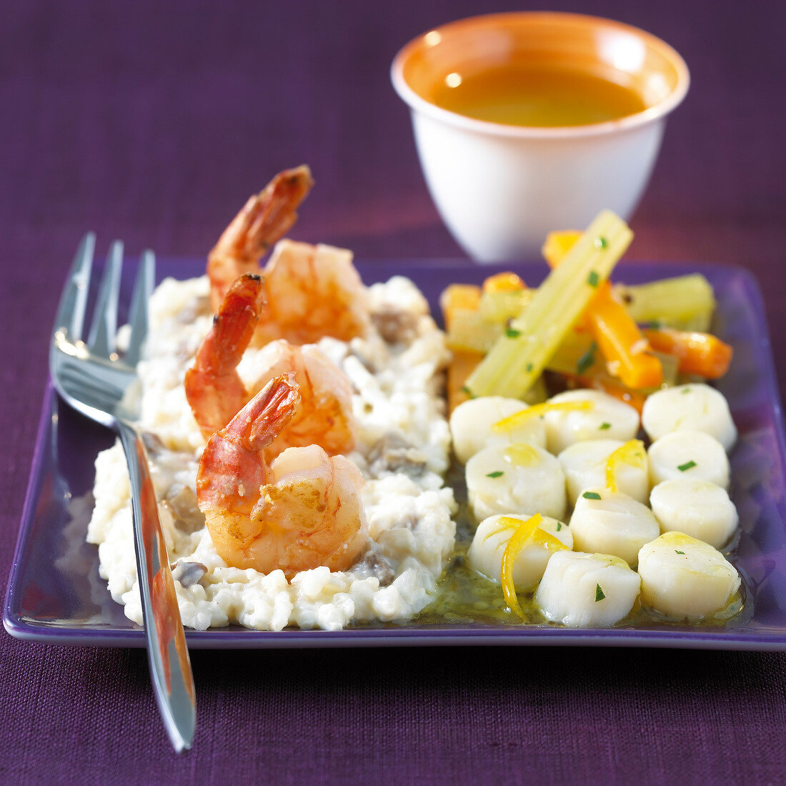Risotto with king prawns,carrots and salsifies with orange sauce
