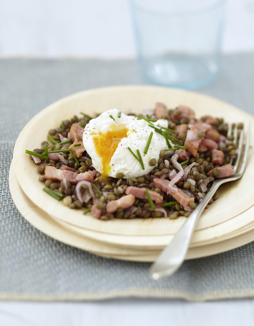 Lentil and diced bacon salad with a poached egg