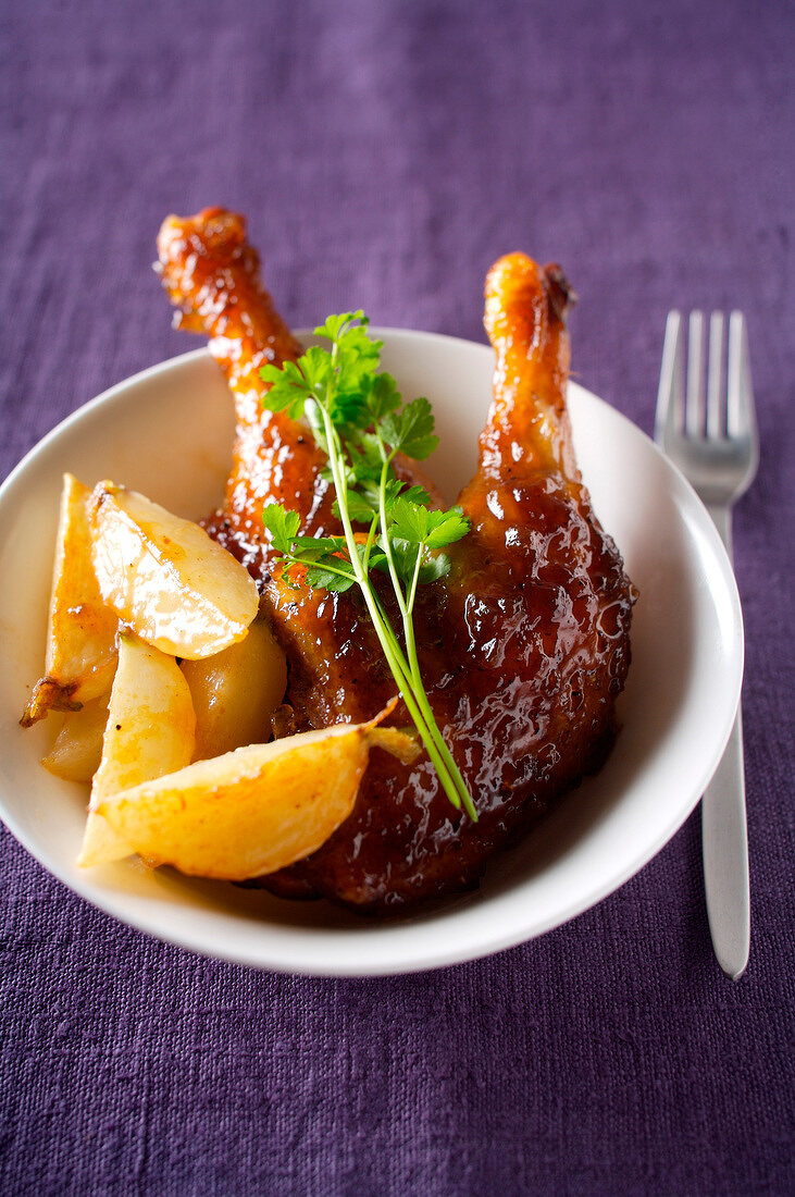 Duck's legs with orange and pan-fried turnips