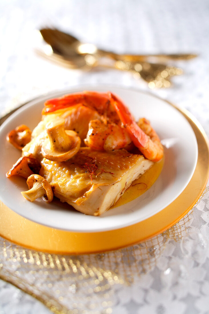 Capon with saffron, shrimps and chanterelles