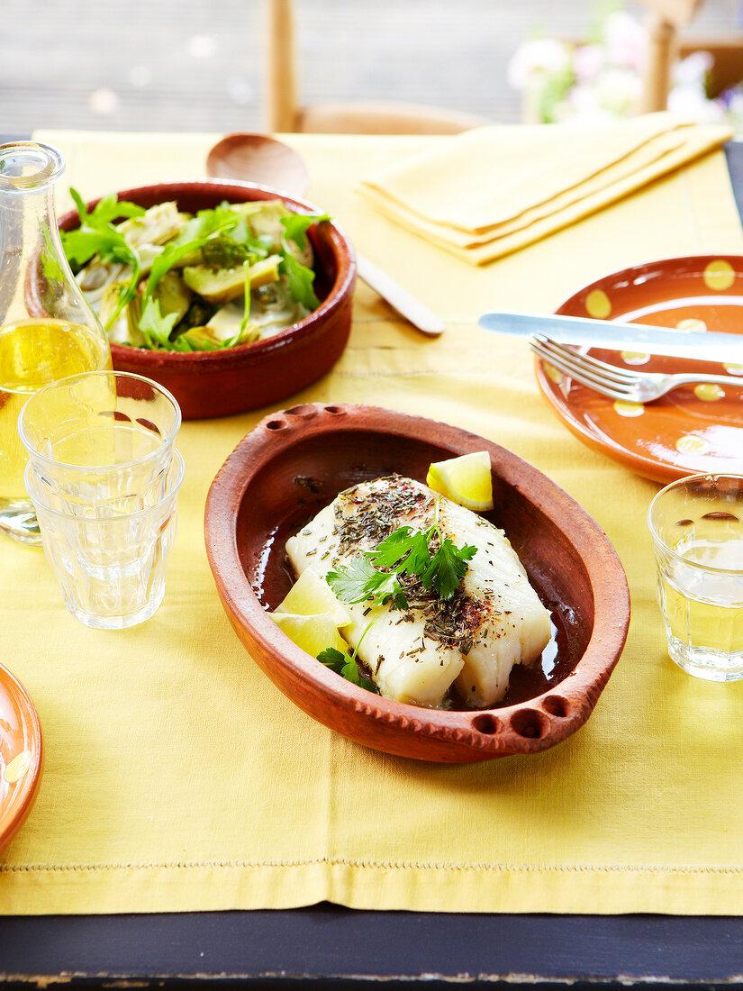 Stemed cod with rosemary and lemon juice, artichoke salad