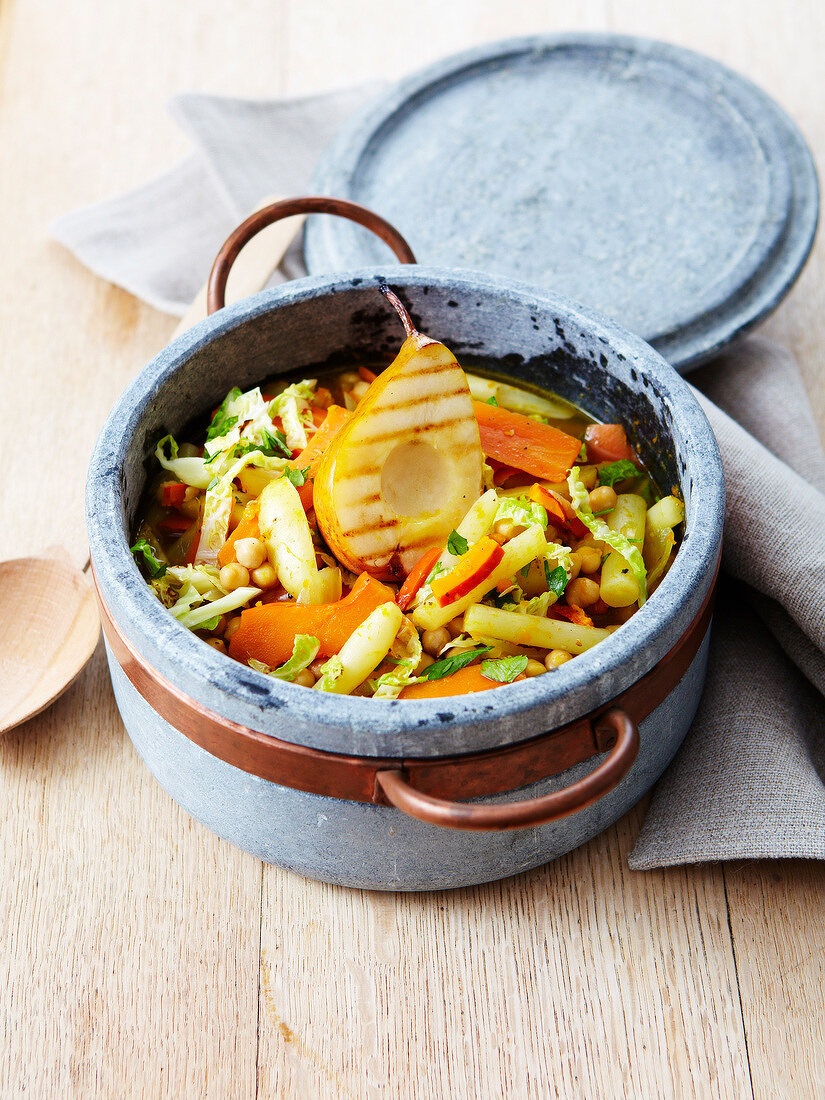 Vegan stew with chickpeas,sweet potato,cabbage,carrots,pear,nectarine and salsifies