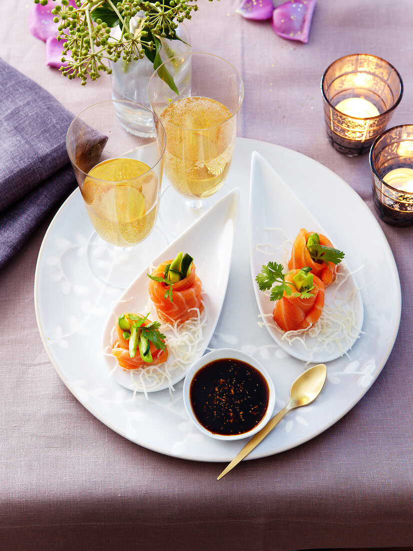 Smoked salmon rolls with cucumber and avocado filling