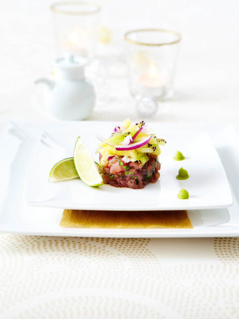 Small red tuna tartare with kwi, pineapple, red onions and lime juice