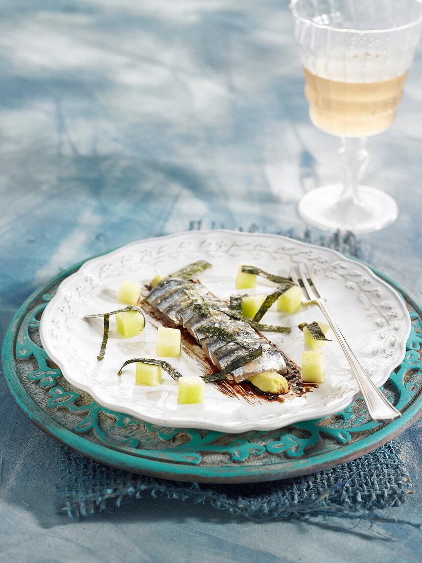 Fresh anchovies with avocado cream, diced honeydew melon and nori seaweed
