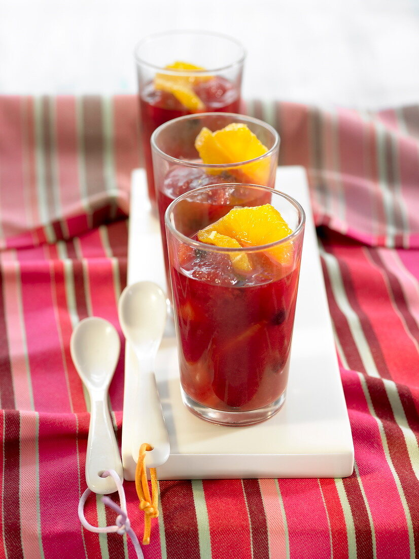 Fresh fruit in hibiscus syrup