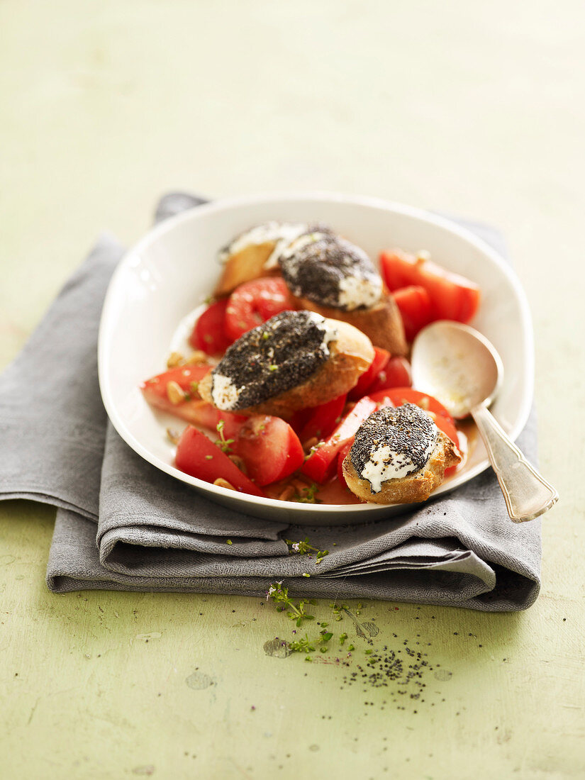 Tomato salad with goat's cheese and poppyseed croutons
