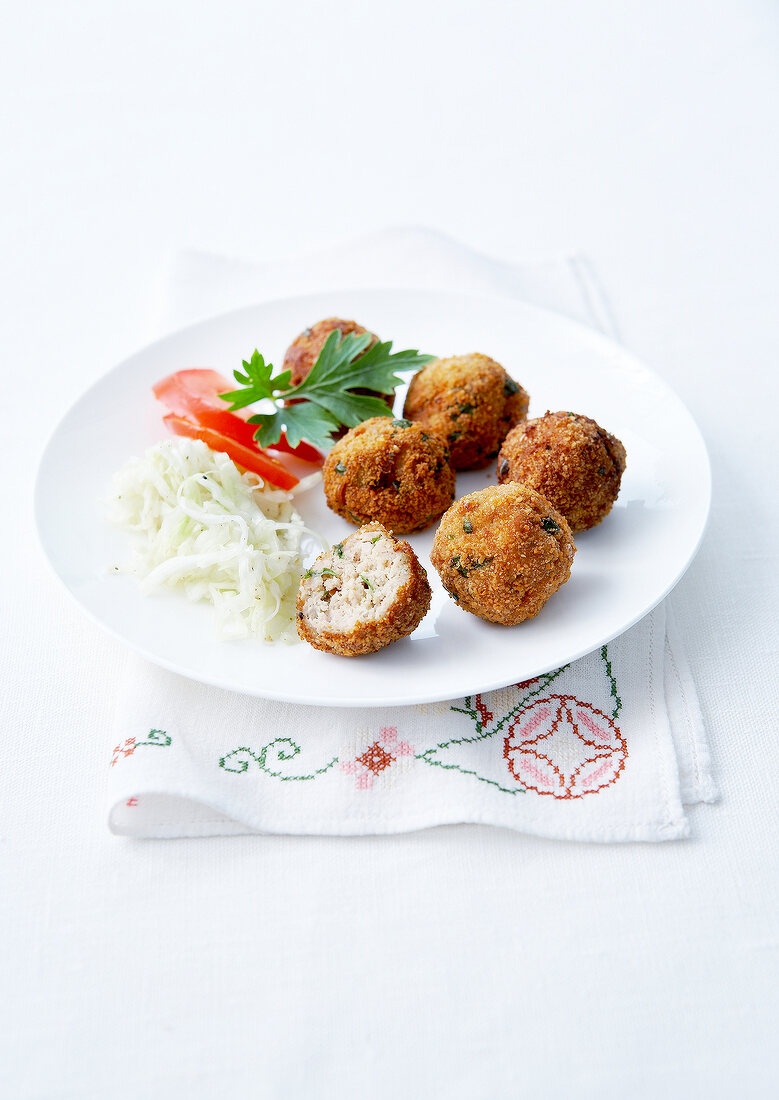 Chicken and parsley croquettes, white cabbage salad