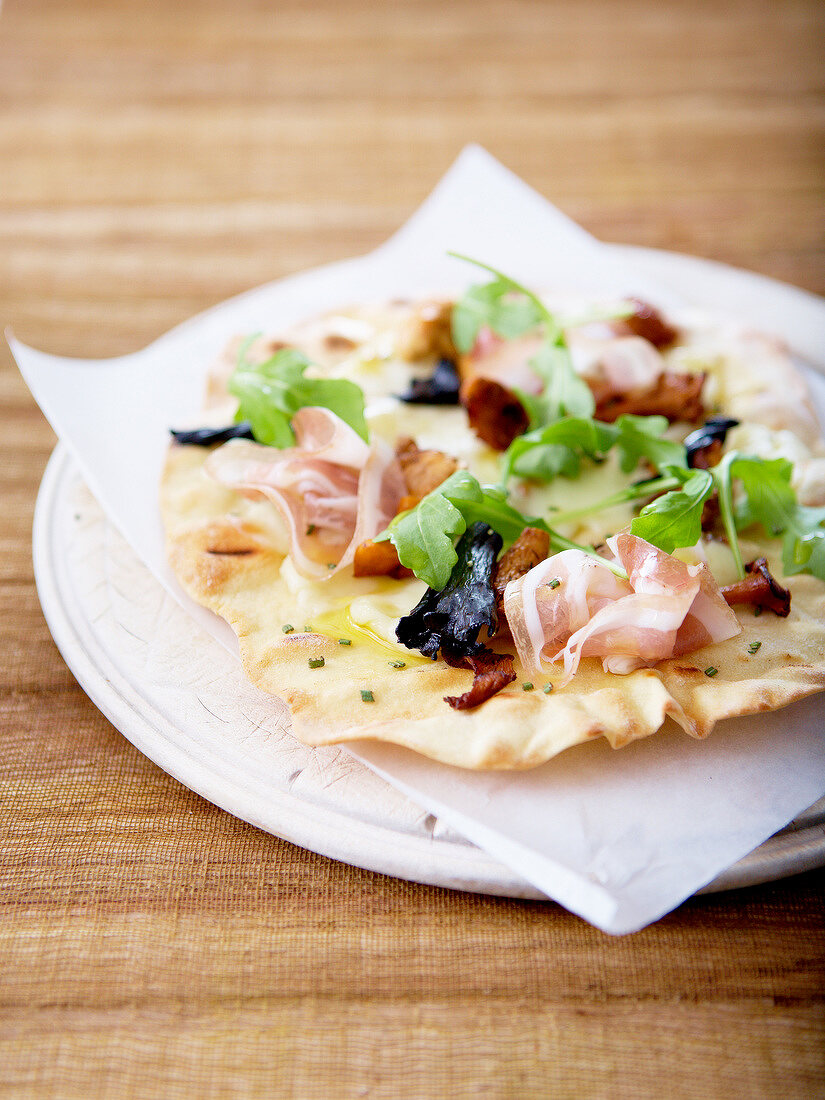 Small cep and pancetta pizzetta with olive oil