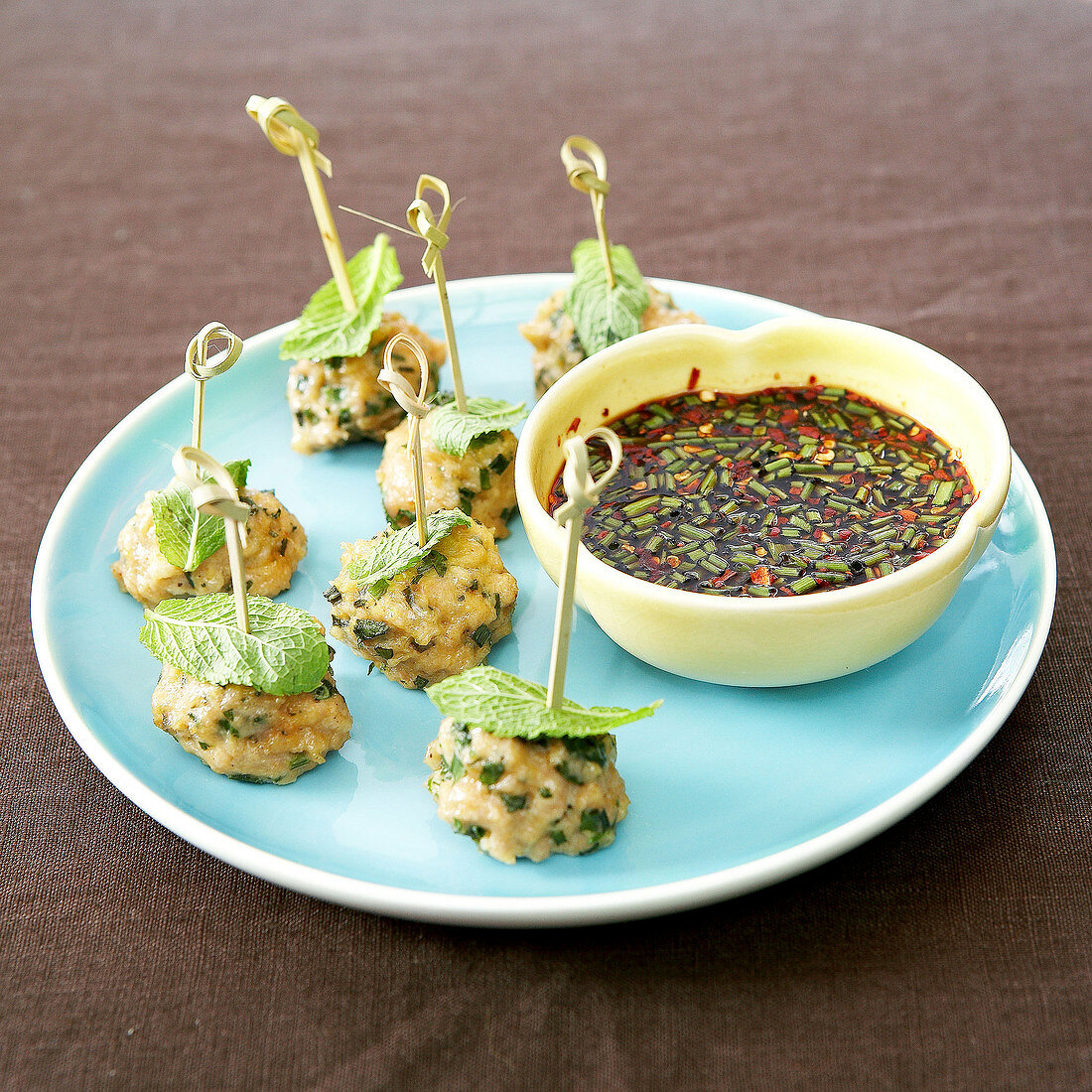 Minty chicken meat balls on sticks,chili pepper and chive suace