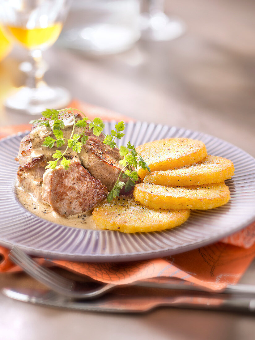 Veal Médaillon in creamy mustard sauce and polenta galettes