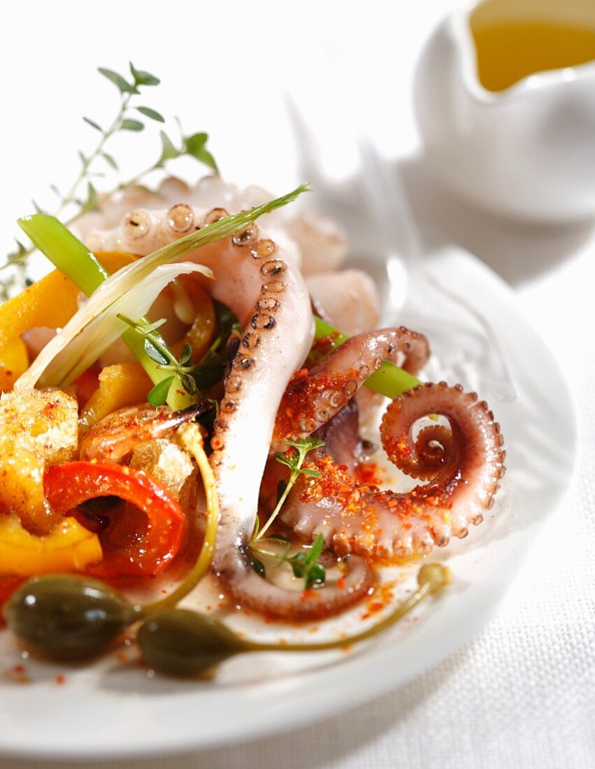 Octopus, pepper and caper salad with red hot pepper dressing