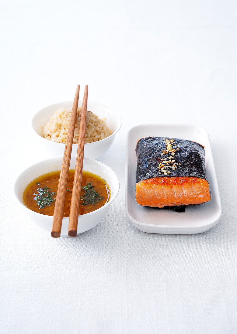 Maki-style cooked piece of salmon,rice and sweet sauce