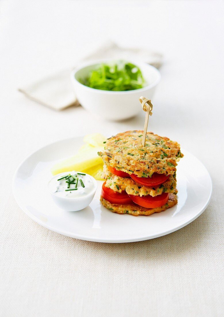 Layered tuna rösti with tomatoes, creamy chive sauce