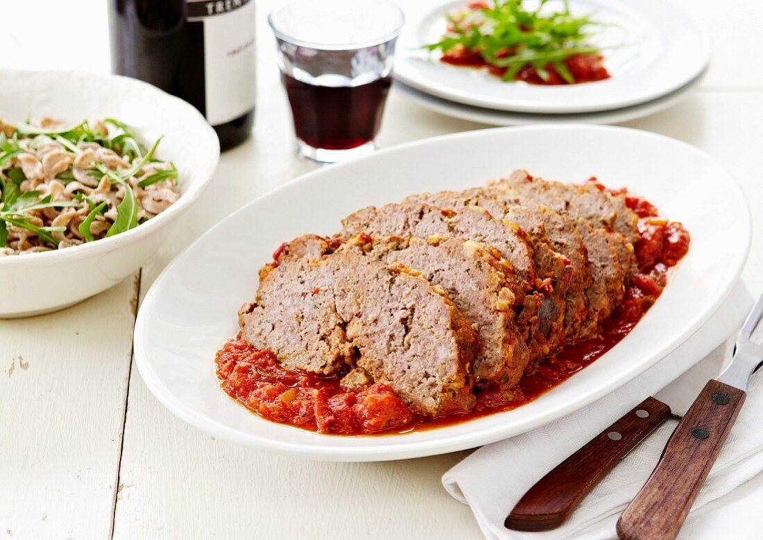 Meat loaf with cooked tomato sauce