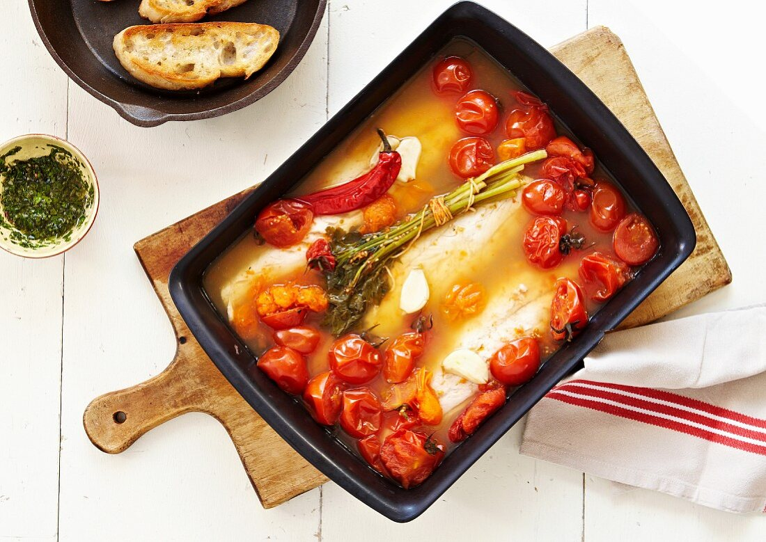 Oven-baked white fish fillets with cherry tomatoes