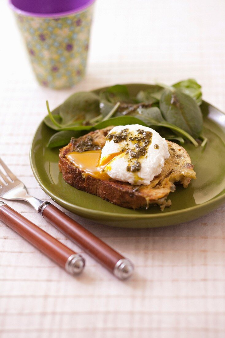 Savoury french toast with pesto and a poached egg