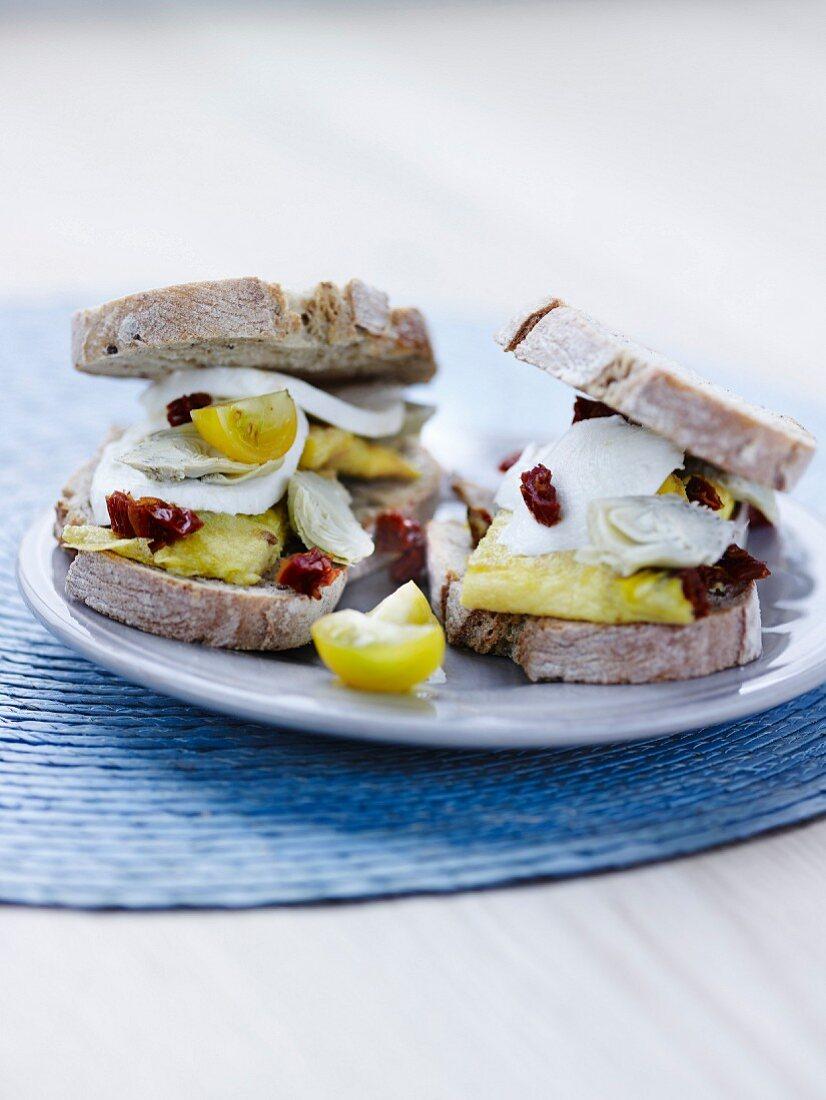 Omelette,confit tomato and small artichoke heart sandwiches