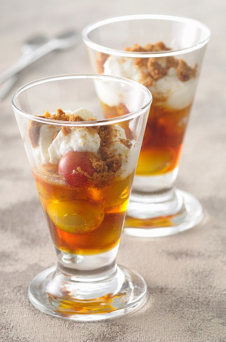 Glasses of faisselle with mirabelle plums and caramel