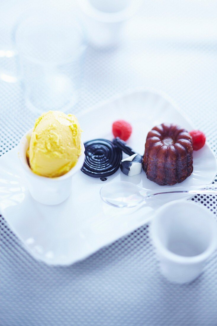 Gourmand coffee with Cannelés,passionfruit sorbet and candies