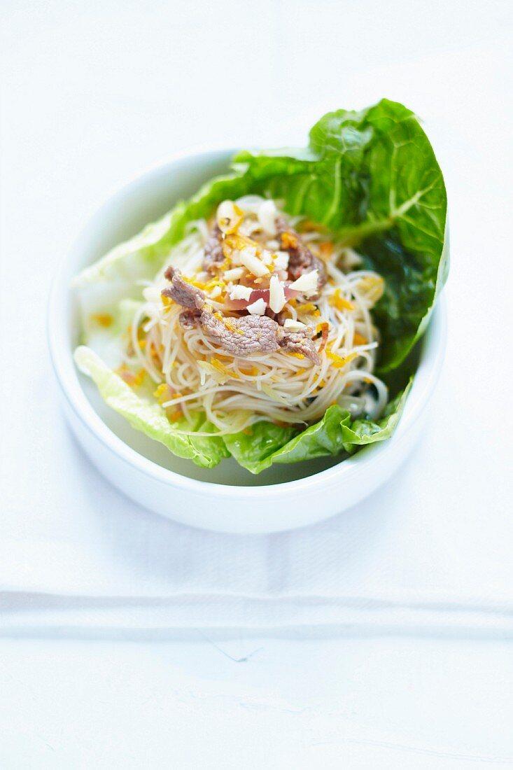 Noodle,beef and citronella salad served in a lettuce leaf