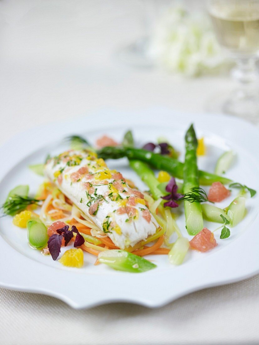 Steamed sea bream,citrus fruit virgin sauce,green asparagus and thinly sliced carrots and leeks