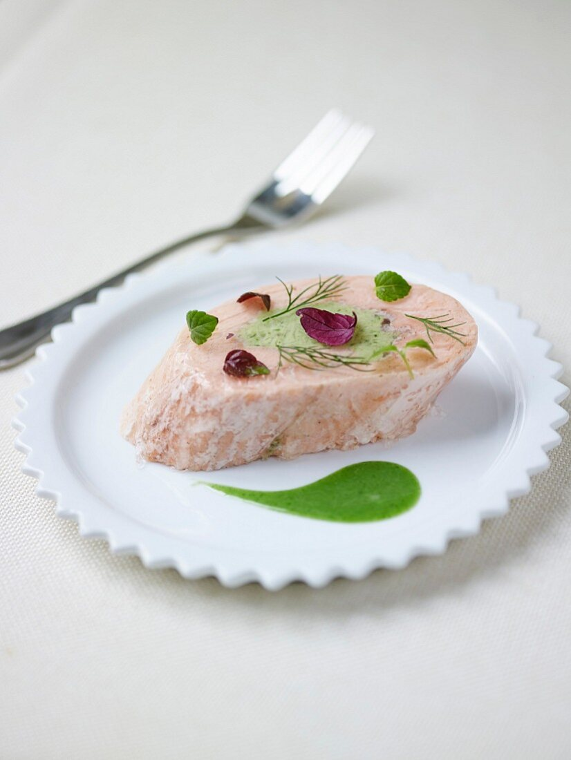 Piece of salmon with creamed dill sauce
