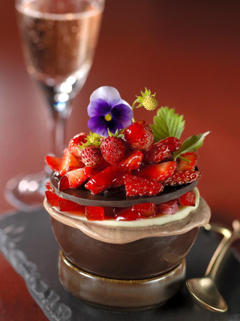 Dark, white and milk chocolate egg with wild and commun strawberries