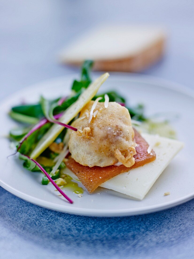 Beignet with Brebis sheep's cheese on quince bread with a mixed leaf salad