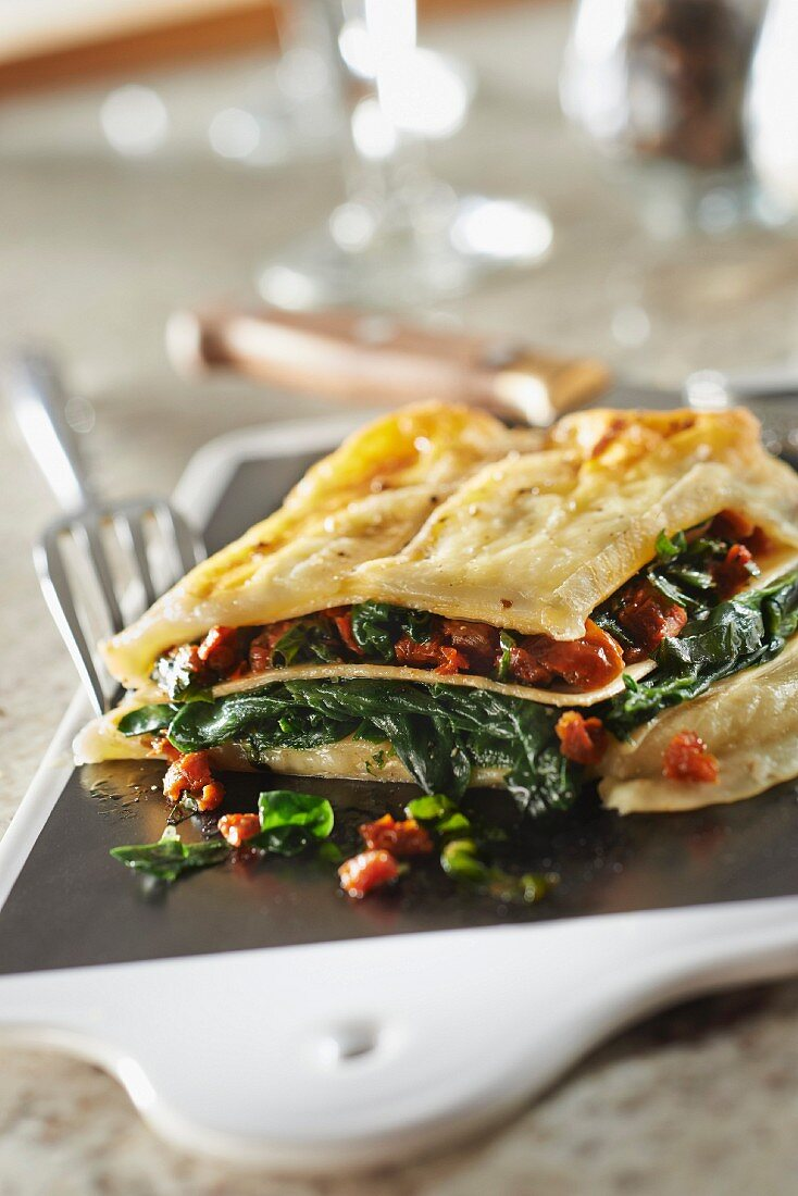 Petit Breton,spinach and confit tomato lasagnes