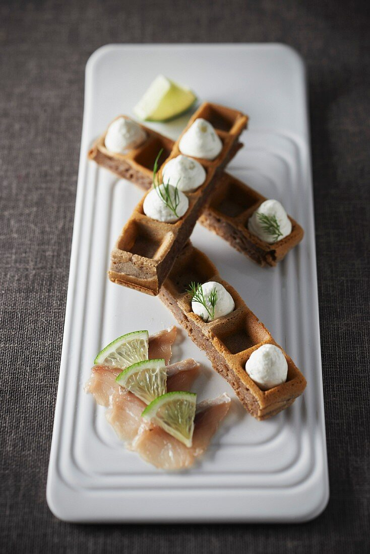Buckwheat waffle with smoked pollock and vodka-dill cream