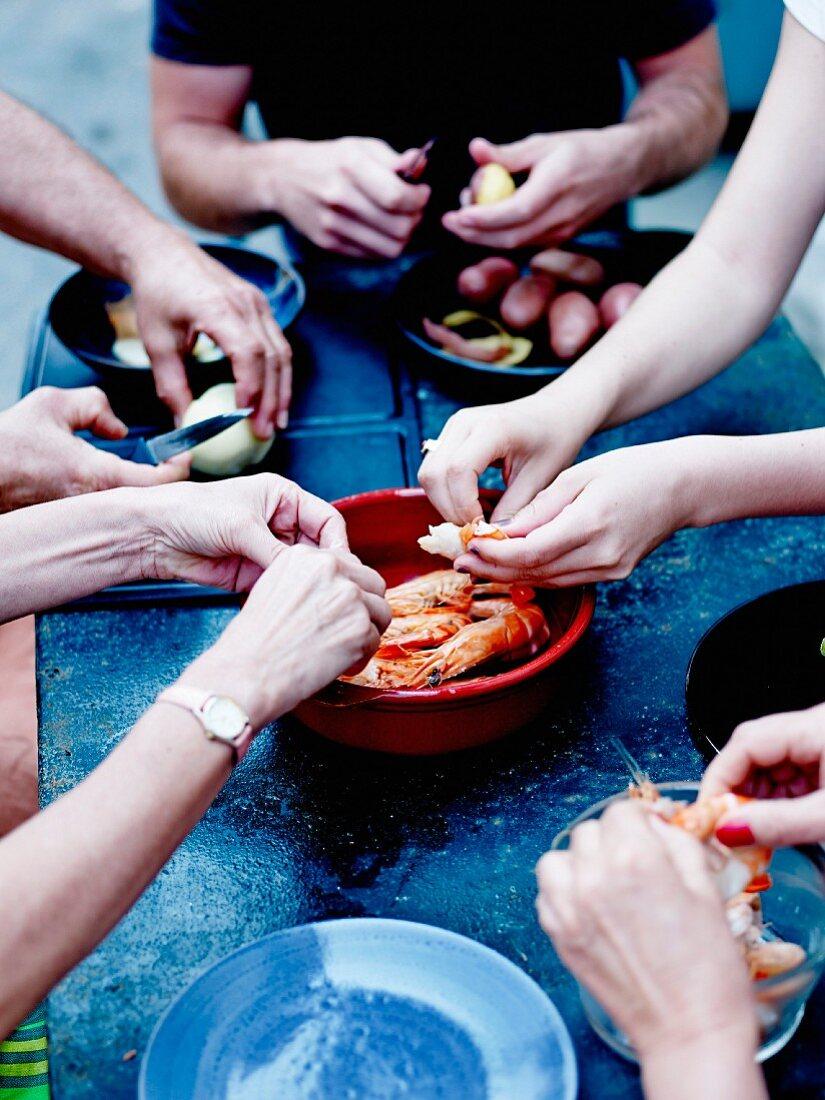 Helpful hands preparing a meal