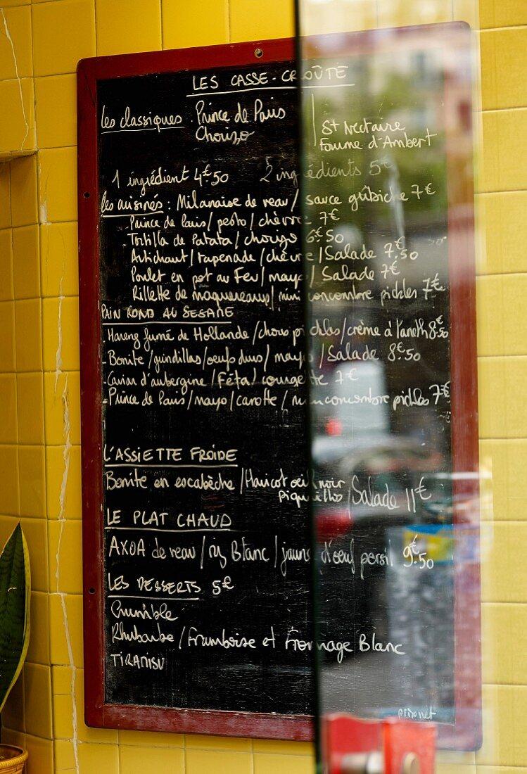 Menu on slate in a sandwich stall