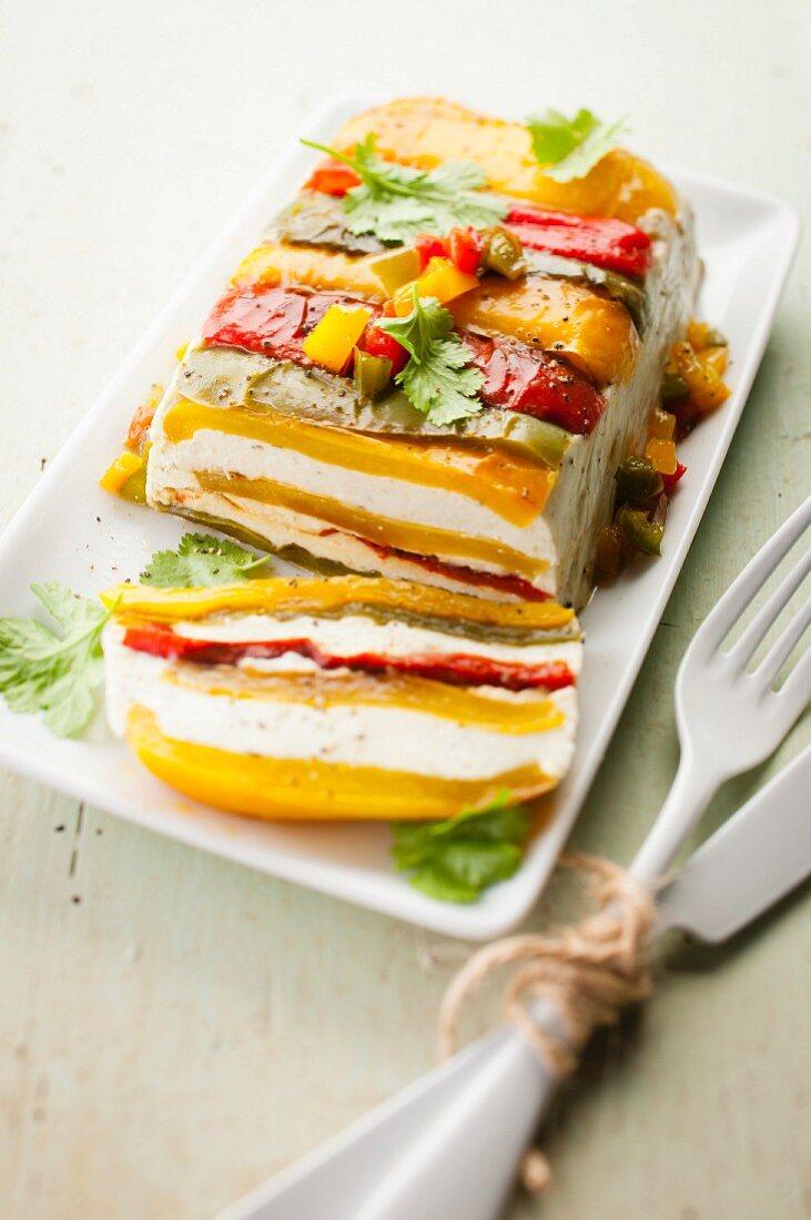Three-colored pepper and cream cheese terrine