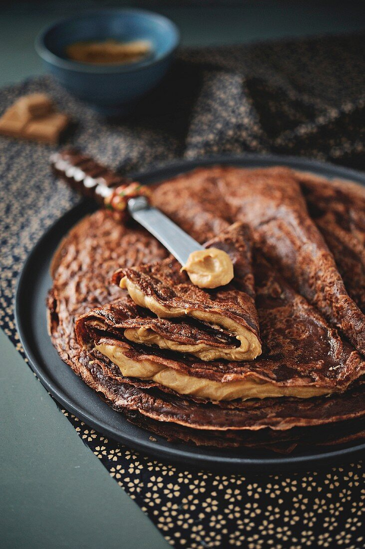 Cocoa Crêpes garnished with coffee cream